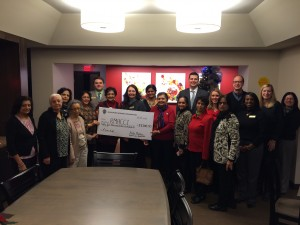 December 18, 2014 – Vasanta Mushunuri , President of the Asian Indian Women's Organization (AIWO), and other members of AIWO presented a $55,000 check to Ronald McDonald House Charities of Central Illinois (RMHCCI) on Wednesday, December 17. The money was raised through their recent 9th India Night held on November 14, 2014.
