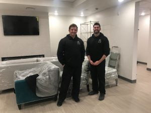 New furniture arrives at the Peoria Ronald McDonald House® thanks to Ethan Allen Delivery's employees.